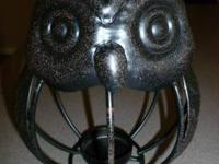 These are black metal spider web candle holders with