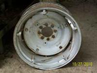 Rims & center disc for ford farm tractor. One does need