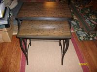 Both are very sturdy tables in great shape. Has kind of