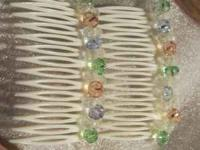 Pair of 2 swarovski crystal hair combs. $8 for both.