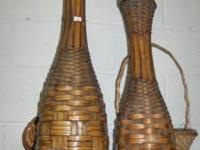 We have a pair of tall bottle shaped wicker baskets for