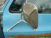 One pair of steel tripod side view mirrors removed from