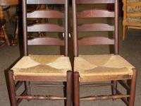 Pair of vintage ladderback chairs with rush seats. The