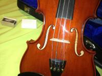 This is a brand new Palatino hand crafted violin with