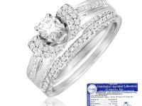 14 Karat white gold diamond ring. Pale blue and white