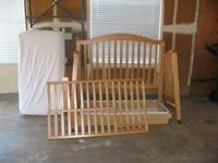 Pali Crib in light wood for sale with mattress. Crib is