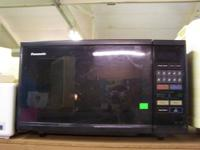 This is a smaller microwave by Panasonic in black.