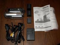 Camera is in great working condition. Includes camera,
