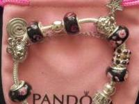 pandora bracelet w/ bag. text or call if you have more