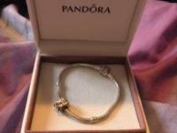 I am selling a brand new pandora charm bracelet with a