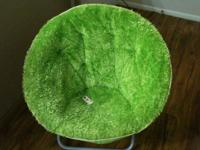 Lime green in color. This chair is portable too, you