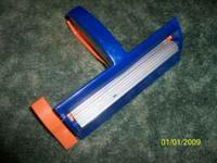 Paper Crimper. Opening for paper is 6 1/2 inches wide,