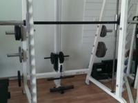 In excellent shape. Olympic weights, bench and leg