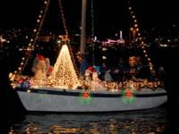 Watch the festively decorated local boats as they make