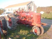 2 antique tractors, 1 farmall M, great running powerful
