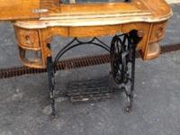 Paragon treadle sewing machine. Nice oak cabinet, but