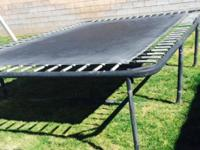 Large rectangular trampoline by park side The size is