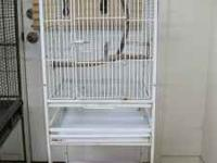 White parrot cage for sale. About 4 1/2 feet tall by