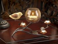 stylized birds nest with bronze candle light
