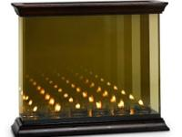 Mirrored candle holder gives the impression of rows and