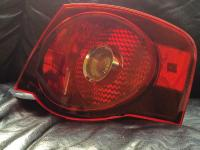 We have one factory OEM passenger right side lamp tail