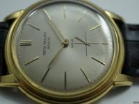 Dial: Original silver dial with gold markers and hands,