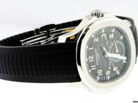 This is a BRAND NEW Patek Philippe Aquanaut Travel Time