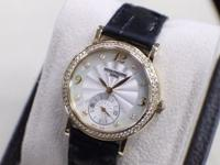 Bezel: 18K Yellow Gold with Diamonds Dial: Mother of