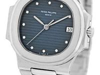dark blue guilloche dial with diamond hour markers,