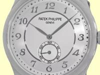 two-tone silvery gray dial with white gold hands and