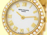 ivory/cream dial with raised gold roman numerals, pave