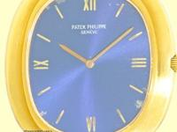 blue dial with gold roman numerals and index hour