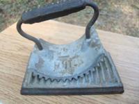 Vintage cast iron fluter made in Geneva, Illinois.