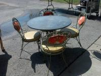 Nice outside or patio furniture. Slate top for the