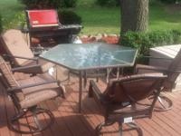 glass top table and 4 chairs  with cushions
