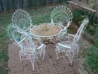 6 piece metal patio set. table, 4 chairs and lounger.
