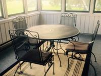 Wrought iron patio table and chairs in Good condition,