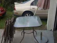 Patio set has table 4 chairs umbrella and stand contact