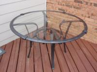 Very cute, sturdy, glass-top patio table with a