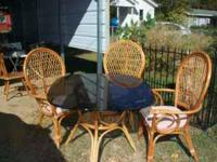 glass and wood out door table and three chairs 85.00