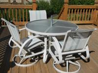 "Round patio table (48"" diameter) and three chairs."