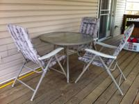 Used patio furniture set 3 chairs and one table. Table