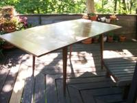 For sale is a Paul Mccobb Planner Group dining table