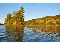 PAYNE LAKE: 5.2 acres with 351 feet along Payne Lake.