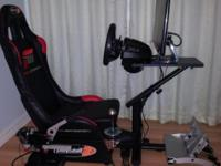 "1. ""Playseat Forza Motorsport 3"" black/red racing seat,"