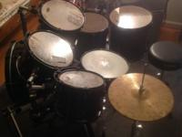 I'm selling an 8-piece PDP drum set. There are 2 bass