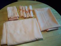 Have a set of matching peach colored table cloths and