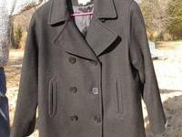 This is a beautiful classic woman's pea coat. The color