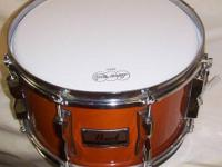 Used Pearl 7x12 Maple Soprano Snare Drum. Attributes: