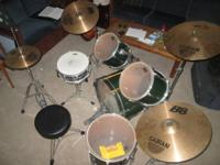 Pearl Drum Set and cymbals for sale. The set consists